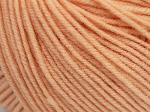 SUPERWASH MERINO is a worsted weight 100% superwash merino yarn available in 47 beautiful colors. Marvelous hand, perfect stitch definition, and a soft-but-sturdy finished fabric. Projects knit and crocheted in SUPERWASH MERINO are machine washable! Lay flat to dry. Fiber Content 100% Superwash Merino Wool, Light Salmon, Brand Ice Yarns, Yarn Thickness 4 Medium  Worsted, Afghan, Aran, fnt2-42469